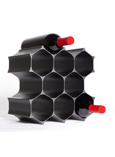 WineHive 10-Bottle Modular Wine Rack starting at 114.75 from WineRacks.com.   Made in the USA from recyclable aluminum, the WineHive is a modular honeycomb wine rack that can grow with your wine collection. The elegant fractal design packs flat for efficient shipping, and is finished in a beautiful Black Satin Anodize or Silver Satin Anodize  Holds up to 10 bottles depending on its orientation.  Combine multiple sets to expand your rack as your collection grows.