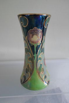 Frederick Rhead for Bursley Ware 451 Pattern Vase | A rare & collectable Frederick Rhead designed vase in the 451 pattern, dating from around 1920. Produced by Bursley Ware (Wood & Sons), Staffordshire, where Rhead was Art Director. This pattern features a printed art nouveau design of a stylised leaf and flower, with a heavily lustred finish. The vases measures approx. 15cm (6″) tall with a base diameter of 7.5cm (3″) | http://www.pinterest.com/anniesland01/rhead-family-ceramics/