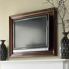 Wall Mounted TV Frame- so never wanted to do this over the fireplace.... but this does look ok.