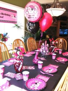 Pretty hot pink and black Pink Skull table for my daughter's birthday party.  The table features theme party supplies, balloons, M & M candies, a lollipop stand and floral arrangements.