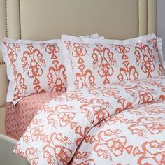 """Three-piece cotton sateen bedding set with an ikat motif in coral pink.  Product: Queen: 1 Duvet and 2 standard shamsKing: 1 Duvet and 2 king shamsConstruction Material: 100% Cotton sateenColor: Coral pink and whiteFeatures: 300 Thread countDimensions: Queen Duvet: 88"""" x 90""""King Duvet: 104"""" x 92""""Standard Sham: 20"""" x 26"""" eachKing Sham: 20"""" x 36"""" each Note: Inserts are not included with shams. Decorative pillows are not included.Cleaning and Care: Machine wash cold"""