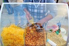 Top Ecuadorian street food dishes to try when visiting Ecuador, from empanadas to espumilllas and salchipapas.