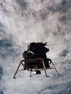 """March 7, 1969 — The lunar module """"Spider"""" in a landing configuration, photographed from the command module on the fifth day of the Apollo 9 Earth-orbital mission. The landing gear on the """"Spider"""" has been deployed. Sensitive lunar surface probes extend out from the landing gear foot pads. Long story short, the Apollo 9 mission was essentially a space scrimmage for the historic Apollo 11 moon shot that took place just a few months later."""