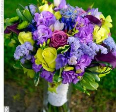 I think this would make a pretty bridesmaid bouquet as long as it didn't clash with their dresses which are royal purple.  I like the pop of yellow.