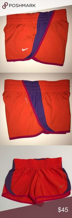 Nike Running Shorts Excellent used condition! Only worn twice. These had built in underwear and I cut them out cause they were very noticeable when wearing the shorts. That's what I'm showing in the last photo, but they are pretty much brand new. Nike Shorts