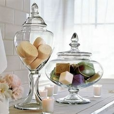 Adding the Accents: Bathroom Decor. Interestingly shaped apothecary glass jars to hold decorative and artisan soaps.