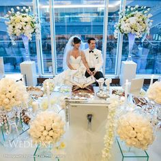 beatiful setup and i like the amount of flowers surrounding the couple