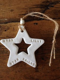 White clay hanging decoration stamped with 'Star by TwoAndBoo
