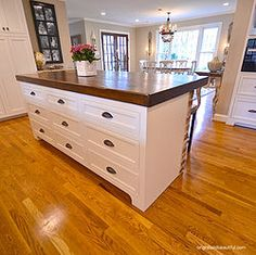 Butcher Block Counter With Black Island And Glazed White