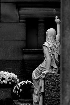 Scene at Pere Lachaise Cem. Not sure if it is a statue or a tomb; but the lady looks real...just cleaning the tomb. So impressive