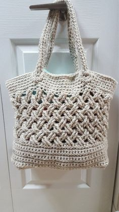 "**THIS LISTING IS FOR THE PATTERN ONLY, NOT A FINISHED ITEM**  This unique tote bag is crocheted flat and seamed together.  Finish dimensions: W 13 x H 10 x D 5  • 6.0mm Crochet Hook • 450yd/412m bulky weight yarn (We used Lion's Pride Woolspun in ""Linen"") • Yarn Needle   Please note refunds are not permitted for digital downloads. Upon completion of your purchase you will receive immediate notification to download your pattern. If you have any problems with the process, please contact us…"