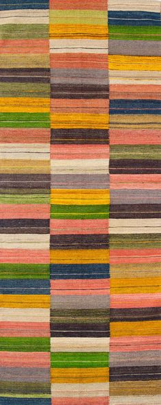 Global Gypsy hallway runners by Scandinavian designer Massimo feature an array of vibrant colour tones on this sophisticated kilim rug
