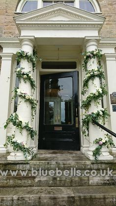 Pillar garlands. Ruscus, eucalyptus, ivy, hygrangea, peony, roses. Installation by Bluebells lincoln ltd. Www.bluebells.co.uk Ivy Rose, Garlands, Beauty And The Beast, Peony, Lincoln, Enchanted, Florals, Castle, June