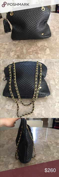 Authentic Bally Bag in Black Lambskin Buttery soft black lambskin with gold hardware and leather tassel. Some wear on zipper but overall excellent condition, clean interior. Dust bag included. This beautiful bag is one of my favorites! Offers welcome Bally Bags Shoulder Bags