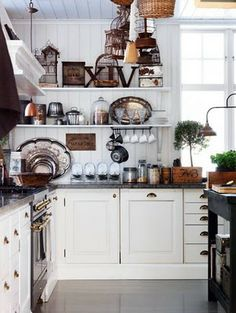 Open shelves and hanging coffee cups, white cabinets, droor pulls!