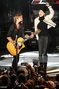Actress Nicole Kidman joins her husband Keith Urban on stage during Jack Daniel's Music City Midnight New Year's Eve Celebration on December 31, 2016 in Nashville, Tennessee. (Photo by Terry Wyatt/Getty Images)