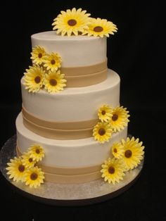 Summery wedding cake with taupe bands and yellow daisies. Party Flavors Custom Cakes, Orlando, F