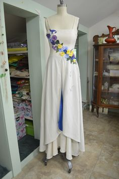 Flowers in full bloom wrap the bodice of this organic cotton wedding dress. Dandelion seeds are embroidered down the skirt lined with a contrast blue hemp silk. Custom made by Tara Lynn Bridal. Cotton Wedding Dresses, Bride Dresses, Dandelion Seeds, Tara Lynn, Bespoke Suit, Unique Weddings, Hemp, Custom Made, Organic Cotton