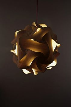 lit on Sculptural DIY Lamp made of Wooden Plates Shade. If there could be such a thing as a sexy lamp, this is it.