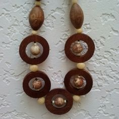 "Wooden Circular Bead Necklace A unique necklace made of a variety of wooden beads. This is a great statement piece in neutral colors that could go with most anything! Length is 12"" and metal clasp is a box clasp with slight tarnishing. No trades. Make a reasonable offer. Please ask any and all questions before purchasing. Thanks! Boutique  Jewelry Necklaces"