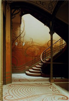 Main Staircase of the Horta House, designed by Victor Horta.   Notice the whiplash curves  mosaic flooring,  iron railings