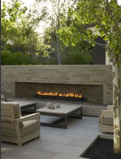 Sleek fireplace for outdoors. I prefer this to the huge, tall outdoor fireplaces.