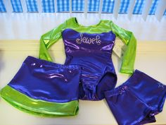 A Flip N Fit custom set (long sleeve leotard, shorts and skirt) for Jewels cheer team. Super cute and affordable! Let us know what your girls gymnastics, cheer or dance team needs!