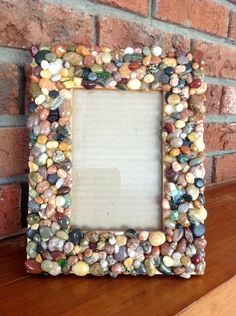 Items similar to Lake Superior Beach Rock Picture Frame - multi-color. on Etsy,Lake Superior Beach Rock Picture Frame - awesome project idea for rocks and pebbles found walking at the beach Frames are decorative accessories that . Beach Rocks Crafts, Rock Crafts, Diy Home Crafts, Lake Superior, Picture Frame Crafts, Homemade Picture Frames, Mirror Crafts, Lake Pictures, Surfing Pictures