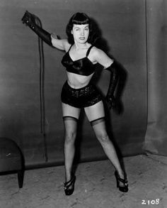 """Bettie Page: Who she is: An American pinup model from the '50s who has been called the """"Queen of Pinups.""""  Why she's scandalous: Besides being one of the earliest Playmates of the Month for Playboy magazine (Miss January 1955), Bettie Page was famous for her fetish and sadomasochistic modeling. In fact, she's considered the first famous bondage model."""