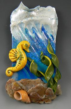 """Quick and easy ocean scene using seahorse from CF """"Sea What You Can Sea"""" mold, """"Shimmer"""" micro mica flakes from CF """"SurfaceFX: Making Waves"""" powder set, and shell from CF """"EmbellishBits: Ocean Commotion"""" set. #seahorse #polymerclay #christifriesen #micapowder #ocean"""