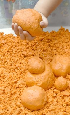 Homemade Pumpkin Moon Sand Recipe- this moon sand has such a FUN & unique texture. It is sand-like but soft and squishy. It can be molded and holds it's shape really well but also has an OOZE to it. It is really hard to describe and so fun you really must try it for yourself (Kids LOVE this stuff!)