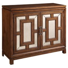 Showcasing mirrored front doors with geometric overlay, this refined chest is perfect for stowing extra table linens in the dining room or towels in your mas...