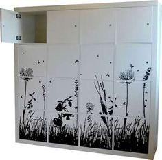 gorgeous!  What a great idea, to add a mural print to doors added to an expedit.