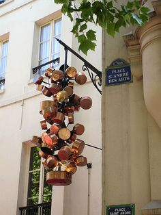 Chez Clement restaurant, Hanging copper pots sign. Place Saint Andres des Arts. Paris.