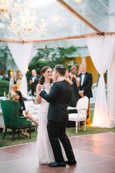 f2dda9e0a6 bride and grooms first dance under marquee tent http   itgirlweddings.com