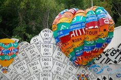 """Balloons (less than 10 tons) - part of the """"Read Between the Signs"""" road sign art mural in Meadville, PA"""
