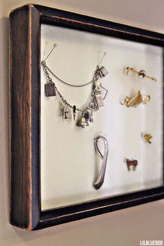 Bathroom decor ideas, how to display jewelry in a shadowbox - via lilblueboo.com #shadowbox #jewelry