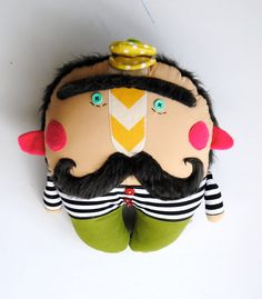 Mr. Mustache is one of a collection of mustache men that I design. They are serious looking fellows, shaped a little bit like a tooth. They