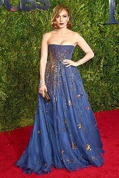"""Booty"" singer Jennifer Lopez modeled a strapless, denim-blue Valentino Couture dress, embellished with gold sequins in a starburst design"