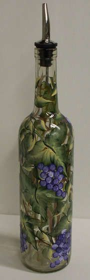 Painted wine bottle to use an an oil decanter. Now if I could only paint. Diane? Lauren? Lea?