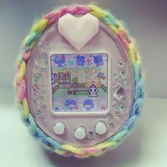 My tamagotchi P! In rainbow crochet cover! The most adorable thing ever.