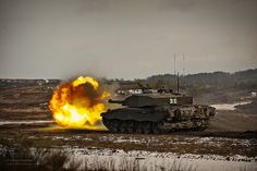 A Challenger 2 main battle tank with The Queen's Royal Hussars (QRH) during a live firing exercise at Hohne ranges in Germany.