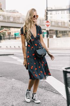 What are the cool ways to wear a dress with sneakers? We're taking a few tips from fashion girls.