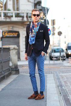 Shop this look on Lookastic:  https://lookastic.com/men/looks/blazer-dress-shirt-chinos-tassel-loafers-tie-pocket-square-scarf-sunglasses-socks/4210  — Dark Brown Sunglasses  — Orange Tie  — White Pocket Square  — Blue Print Scarf  — White Dress Shirt  — Navy Blazer  — Blue Chinos  — Charcoal Socks  — Brown Suede Tassel Loafers