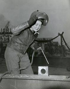 Hazel Licuori raises her helmet and takes a breath before resuming her job as an oxyacetylyne burner, (Official U. Navy Photograph/New-York Historical Society) Women In American History, Go Navy, Jobs For Women, New York Homes, Rosie The Riveter, Take A Breath, Beautiful Dream, Great Women, Historical Society