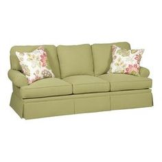 Sofa with a blendown fill and two throw pillows. Made in the USA.  Product: SofaConstruction Material: Faric and foamColor: BasilFeatures:  Made in the USAIncludes two throw pillows Dimensions: Sofa: 19 H x 61.5 W x 23 D Pillow: 21 x 21 each