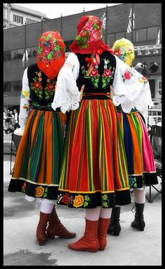 Real dancers from Poland wear red boots.
