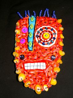 Stucky Tribal Voo Doo mask  Fabric beaded and by STUCKYOUTSIDERART, $35.00  use discount code MD2012 for 40% off entire shop!