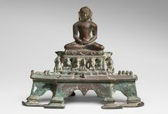 Philadelphia Museum of Art - Collections Object : Jina Adinatha Geography: Made in Gujarat, India, Asia or Rajasthan, India, Asia Date: 11th - 12th century Medium: Copper Alloy Dimensions: 9 5/8 × 11 5/8 × 5 inches (24.4 × 29.5 × 12.7 cm) Curatorial Department: South Asian Art Object Location: Currently not on view  Accession Number: 1963-141-2 Credit Line: Gift of Stella Kramrisch, 1963