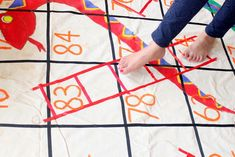 playing giant sankes and ladders game